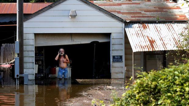 Kent Kirk looks out from his garage flooded by Tropical Storm Harvey in Rose City, Texas. Photograph: Jonathan Bachman/Reuters