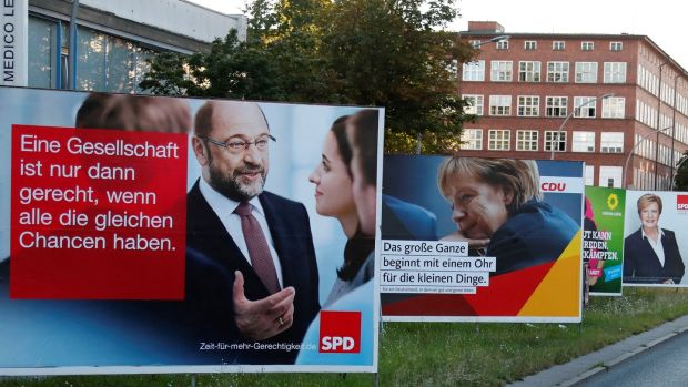 Election campaign posters for the upcoming general elections of the Christian Democratic Union party in Berlin. Photograph: Fabrizio Bensch/Reuters