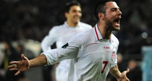 Georgia's Jaba Kankava  celebrates his team victory during their Euro 2012 qualifying  match against Croatia in Tbilisi on March 26, 2011. Photograph: AFP