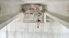Spanish architect designs home and studio space under a bridge
