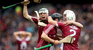 Galway's Caimin Killeen, Daniel Loftus and Mark Gill celebrate their win over Kilkenny in the minor semi-final. Photograph: Ryan Byrne/Inpho