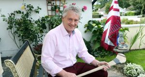 Iggy Clarke with a hurley from his playing days at his home in Oranmore. Photograph: Joe O'Shaughnessy