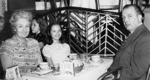 The author, aged 9, in Billy Rose's Diamond Horseshoe, a New York restaurant, with her mother, Eleanor, and her father, Peter