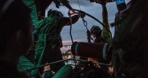 Rescue mission: US airmen search for trapped residents of the Texas city of Beaumont. Photograph: Christopher Lee/New York Times