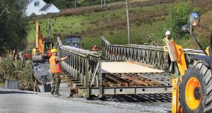 The Irish Army building a replacement road bridge on the main Carndonagh to Quigley's Point road in Donegal after the original bridge was destroyed in last week's floods. Photograph:  Margaret McLaughlin