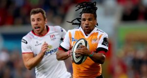 Rosko Specman of the Cheetahs is chased by Ulster's Tommy Bowe during the Guinness Pro 14 game at the  Kingspan Stadium. Photograph: James Crombie/Inpho