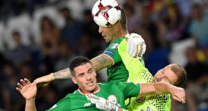 Ireland's Shane Duffy  heads home  past Georgia's goalkeeper Giorgi Makaridze  during the   World Cup group D qualifying  match  in Tbilisi. Photograph:  Mladen Antonov/AFP/Getty Images