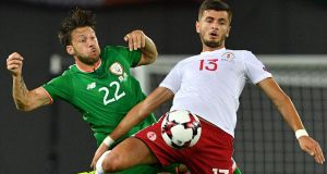 Ireland's Harry Arter vies with Georgia's Giorgi Kvilitaia  during the  World Cup group D qualifying match in Tbilisi. Photograph: Mladen Antonov/AFP/Getty Images