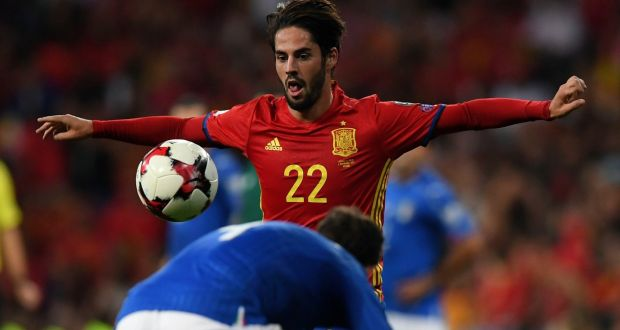c68ad5d0d Spain s midfielder Isco eyes the ball during the World Cup 2018 qualifier  against Italy at the