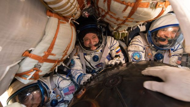 Expedition 52 Flight Engineer Peggy Whitson, Commander Fyodor Yurchikhin of Roscosmos and Fight Engineer Jack Fischer of Nasa inside the Soyuz MS-04 spacecraft shortly after it landed near the town of Zhezkazgan, Kazakhstan