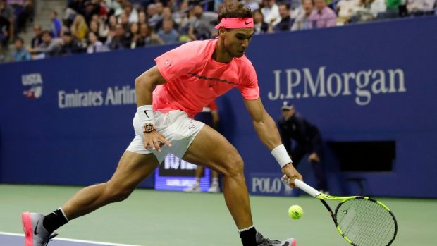 Nadal chases a shot during his win over Mayer. Photo: Julio Cortez/AP