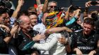 Lewis Hamilton celebrates victory in the Monza Grand Prix. Photograph: Srdjan  Suki/EPA