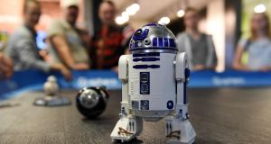 Visitors look at the remotely controlled R2-D2 robot from the Star Wars movies at the IFA Consumer Electronics Fair in Berlin. Photograph: Getty Images