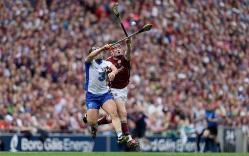Galway's Conor Whelan and Noel Connors of Waterford compete for the sliotar. Photo: Tommy Dickson /Inpho