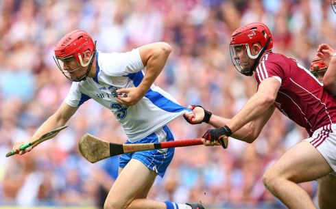 Galway's Jonathan Glynn pulls back Tadhg De Burca of Waterford. Photo: Cathal Noonan/Inpho