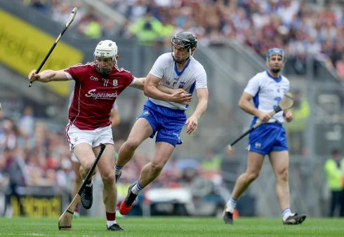 Waterford's Pauric Mahony drops his hurl as he attempts to tackle Joe Canning of Galway. Photo: Tommy Dickson/Inpho