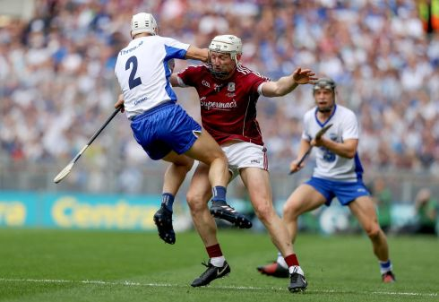 Galway's Joe Canning stops Shane Fives of Waterford. Photo: Tommy Dickson/Inpho