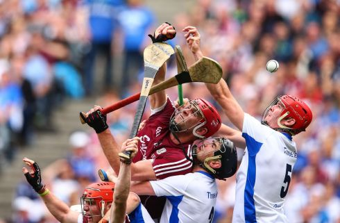Galway's Conor Whelan and Jonathan Glynn battle with Barry Coughlan and Tadhg De Burca of Waterford. Photo: Cathal Noonan/Inpho