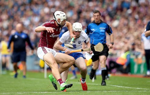 Galway's Gearoid McInerney tackles Shane Bennett of Waterford. Photo: Ryan Byrne/Inpho