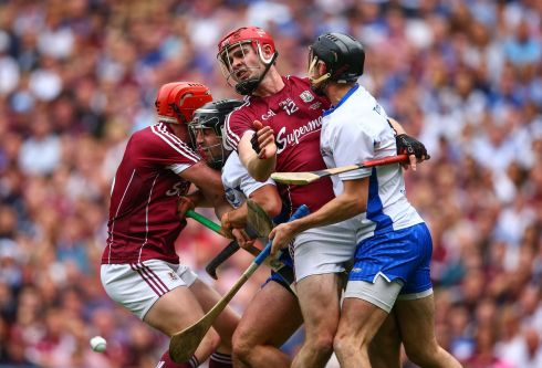 Galway's Conor Whelan and Jonathan Glynn battle with Noel Connors and Barry Coughlan of Waterford. Photo: Cathal Noonan/Inpho