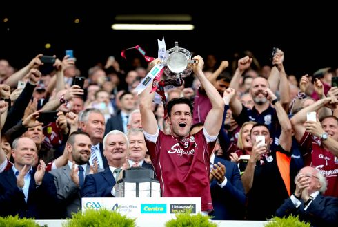 Galway's David Burke lifts the Liam McCarthy to end the 29 year famine for the Tribesmen. Photo: Ryan Byrne/Inpho
