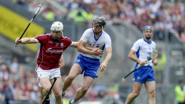 Joe Canning holds off Pauric Mahony. Photograph: Tommy Dickson/Inpho