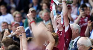 Galway's Darren Morrissey lifts the trophy after winning the All-Ireland Minor Hurling Championship against Cork at Croke Park. Photo: Tommy Dickson /Inpho