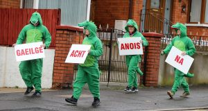 Irish-language campaigners dressed in crocodile costumes outside a DUP MLA's office in Belfast. Photograph: Justin Kernoghan