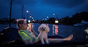 "Waiting to be rescued: Houston has suffered three ""500-year floods"" in the past three years. Photograph: Adrees Latif/Reuters"