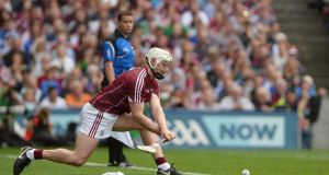 Joe Canning stoops to take a sideline cut during Galway's win over Waterford. Photograph: Piaras Ó Mídheach/Sportsfile via Getty