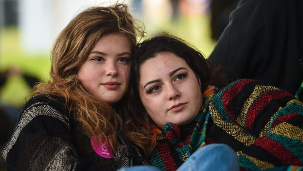 "Aisling Mahon, left, and Lauren McBride, both from Greystones, Co Wicklow, pictured watching the film ""Police Academy"" Photograph: Cody Glenn/Sportsfile"
