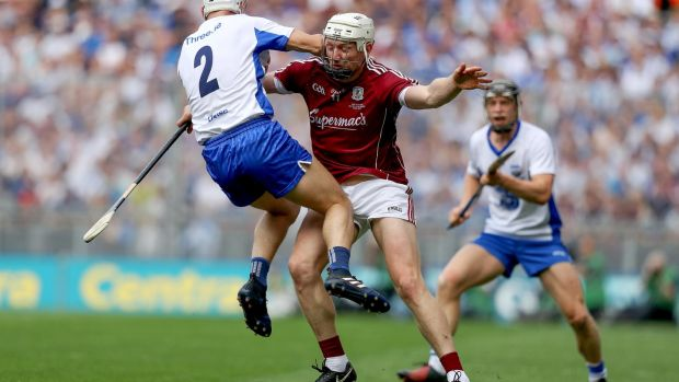 Joe Canning stops Shane Fives as he attempts to go past. Photo: Tommy Dickson/Inpho