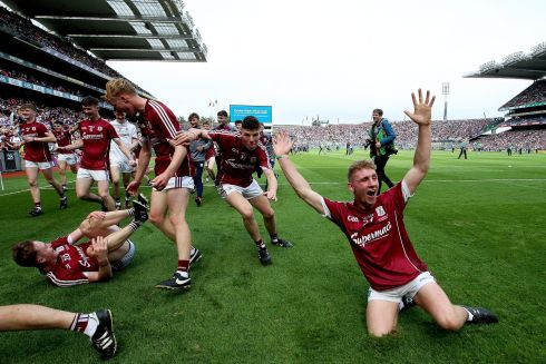 CELEBRATION TIME: Galway's Mark Kennedy celebrates after the hurling final win over Waterford. Photograph: Tommy Dickson/Inpho