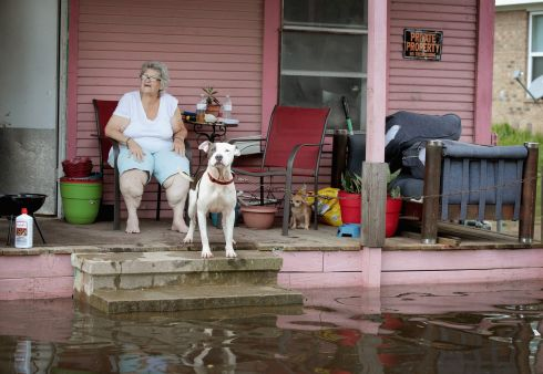 TORRENTIAL RAINS: Rena Brannon sits at the porch of her flood-surrounded home at Orange, Texas, after torrential rains pounded the region following Tropical Storm Harvey. Photograph: Scott Olson/Getty Images