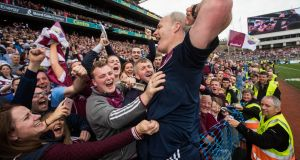 Micheál Donoghue celebrates with Galway supporters after his side beat Waterford to win the All-Ireland SHC. Photograph: Ryan Byrne/Inpho