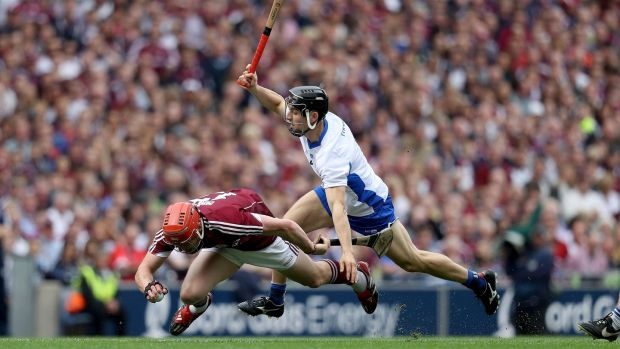 Galway's Conor Whelan is challenged by Jamie Barron of Waterford. Photograph: Tommy Dickson/Inpho