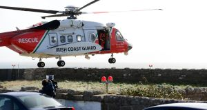 An Irish Coast Guard helicopter takes part in the search  for missing Rescue 116 helicopter crew at Blacksod, Co Mayo in March. Photograph: Dara Mac Dónaill