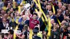 Galway's Johnny Coen lifts the Liam MacCarthy trophy after beating Waterford in the GAA All-Ireland Senior Hurling Championship Final at Croke Park. Photograph: Tommy Dickson/Inpho