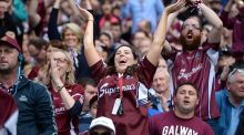 Galway fans celebrate beating Waterford in the All-Ireland senior hurling final. Photograph: Dara Mac Dónaill