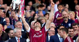 Galway's Jason Flynn  celebrates with the Liam McCarthy Cup. Photograph: James Crombie/Inpho
