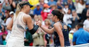 Maria Sharapova  congratulates Anastasija Sevastova after she was knocked out of the US Open by the 16th seed. Photograph: John G. Mabanglo/EPA