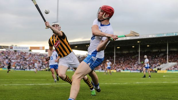 Tadhg de Burca under pressure from Kilkenny's TJ Reid. Photograph: Cathal Noonan/Inpho