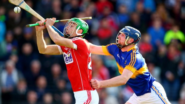 Cork's Michael Cahalane is challenged by Tipp's Thomas Hamill. Photograph: Cathal Noonan/Inpho