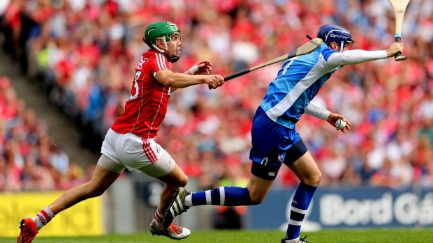 Stephen O'Keeffe evades Cork's Alan Cadogan. Photograph: James Crombie/Inpho