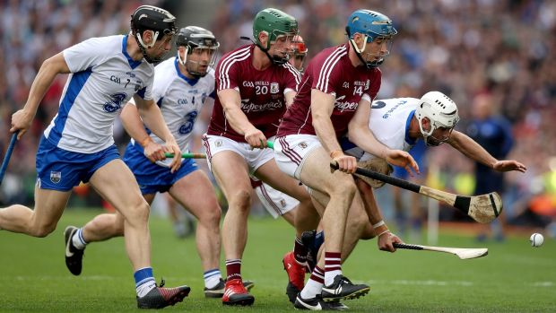 Galway's Conor Cooney challenges Waterford's Shane fives during the All-Ireland final. Photograph: Ryan Byrne/Inpho
