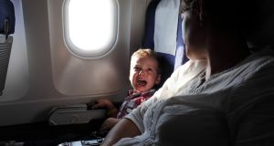 Pack sweets to suck or something to chew for take-off and landing, it relieves ear pressure which children are more prone to. Photograph: Istock