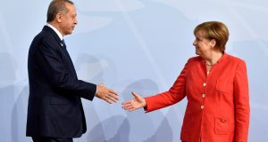 German chancellor Angela Merkel greets Turkey's president Recep Tayyip Erdogan at the beginning of the G20 summit in Hamburg, Germany, on July 7th. Photograph: John MacDougall/Reuters
