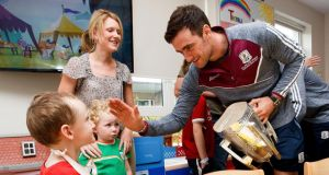 All-Ireland champions: Galway captain David Burke with Martin Cummins at Our Lady's Children's Hospital, in Crumlin. Photograph: Bryan Keane/Inpho