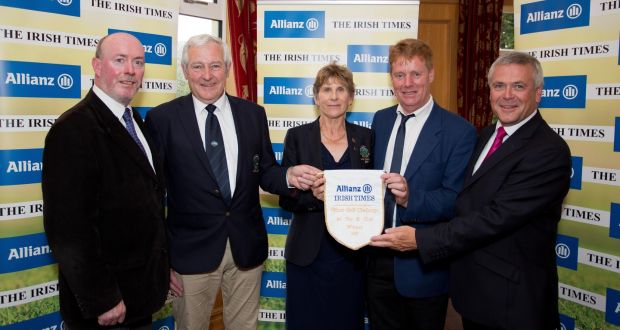 Philip Reid (The Irish Times), with the victorious Gort GC team, Michael McMahon, captain, Margaret McMahon, lady captain, Gerry Broderick and Sean McGrath CEO of Allianz at the K Club. Photograph: Tom Honan.