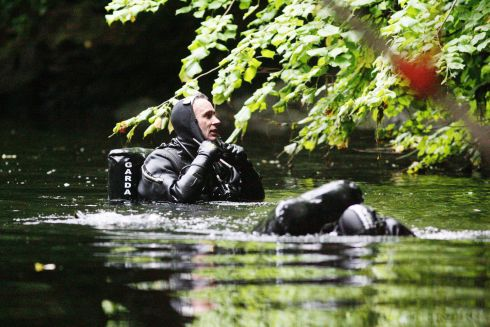 TREVOR DEELY: Members of the Garda Sub Aqua team participate in the search for clues as to the whereabouts of missing man Trevor Deely in the River Liffey at Chapelizod. Photograph: Padraig O'Reilly